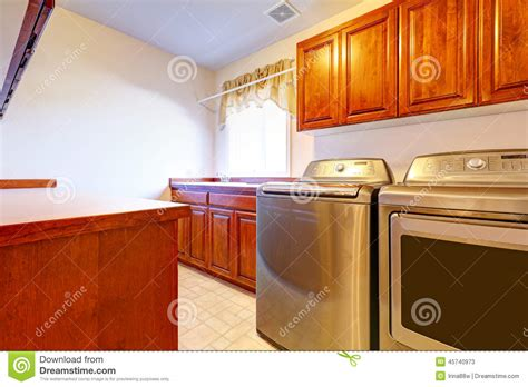 Room Appliances by Laundry Room With Modern Steel Appliances Stock Photo