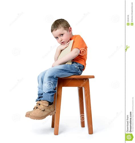 White Sitting Chair by Child Sitting On A Chair With A Book On White Background