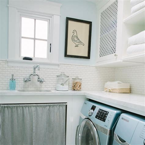 cottage blue laundry room with turquoise washer and dryer cottage laundry room