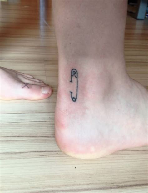 simple ankle tattoos simple safety pin on ankle