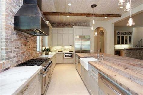 exposed brick backsplash kitchen pale gray cabinets steel exposed brick