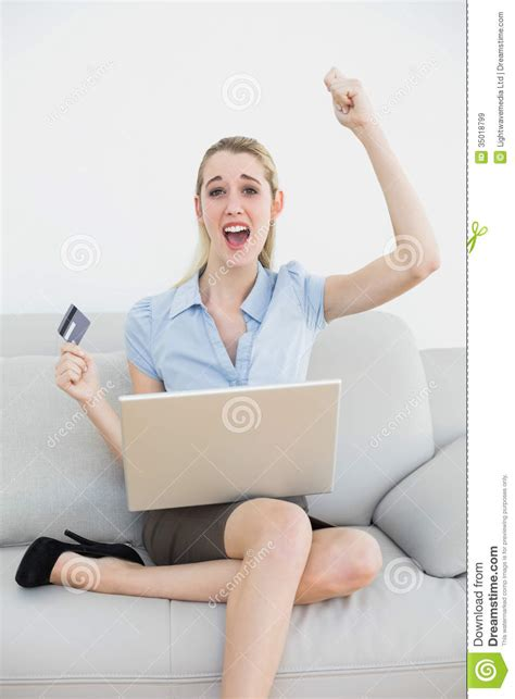 couch online shopping happy classy businesswoman online shopping using her