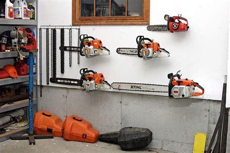 Lawn Mower Storage Rack by Chainsaw Storage Garage Ideas