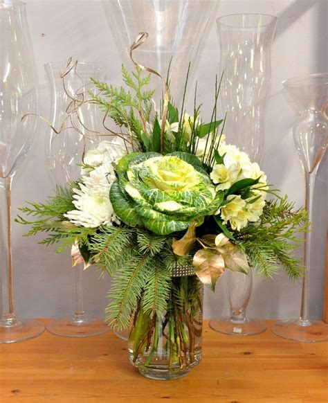 large seasonal vase arrangement funeral tributes and