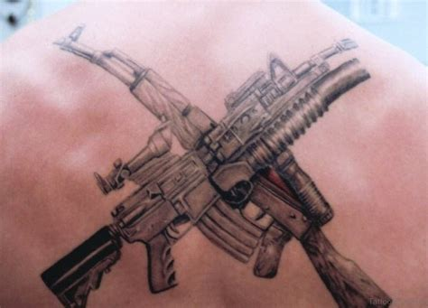crossed guns tattoo 64 ultra modern gun tattoos for back