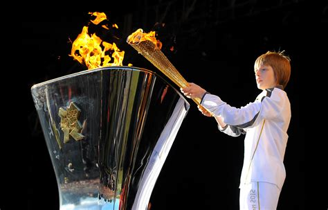Lighting Olympic Torch by The Olympic Arrives In