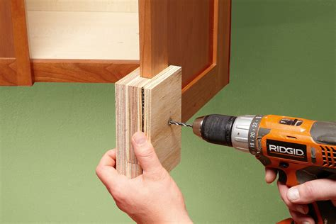 cabinets with handles in the middle do it yourself tips for replacing cabinet handles and