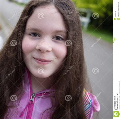10 year old girl with brown hair pretty smiling middle school girl stock photo image