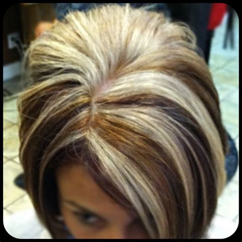 short hair with lots of color lots of blonde highlights with caramel and violet hair