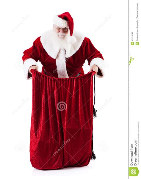 santa claus holding open magic bag of gifts stock photo