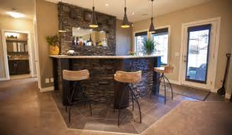 Designer Dining Room Sets Stone Basement Wetbar And Dark Wood Cabinetry