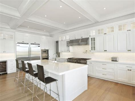 white kitchen with island white kitchen island with dark wood barstools