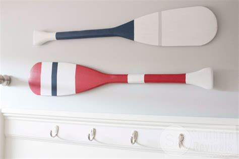 how to hang oars or paddles in an x shape the inspired tutorial diy boat oar wall decor bathroom renovation
