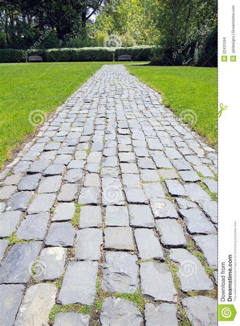 Plants For Formal Gardens - garden cobblestone path stock images image 32431594