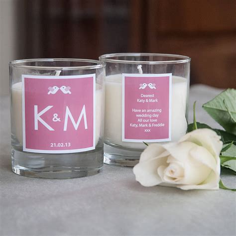 personalised initial wedding candle by kisses and