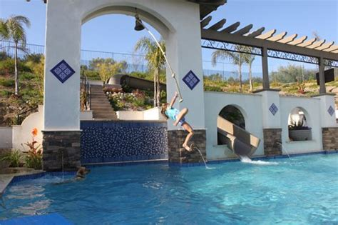 rope swing into pool backyard becomes entertainer s delight landscaping network