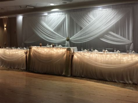 head table draping fabric flowers set the mood decor