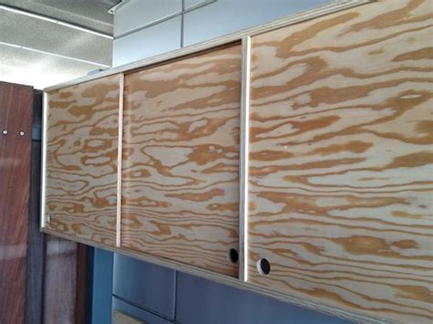 Sliding Door Plywood Cabinet By Roberto Gil Red Hook Tv How To Make Kitchen Cabinet Doors From Plywood