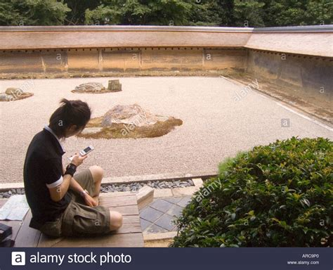 ryoanji rock garden japan kyoto checking text messages in rock
