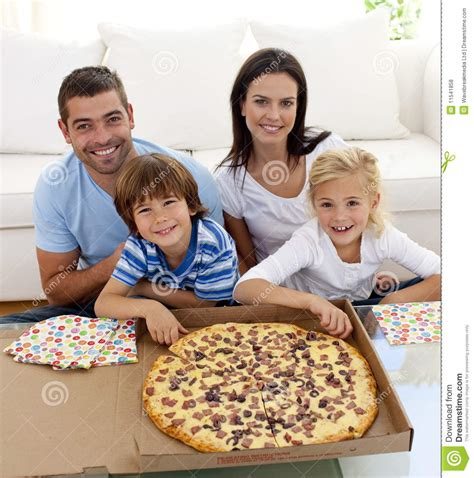 pizza couch family eating pizza on sofa stock photo image 11541858