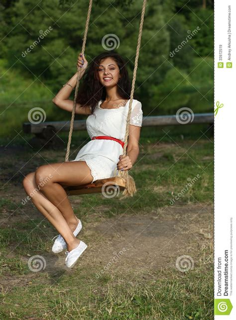 swing woman happy woman riding on a swing in the park royalty free