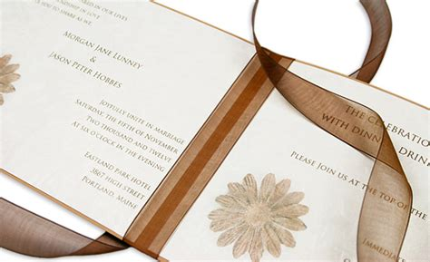 tying ribbon for wedding invitations brown floral booklet invitation for autumn wedding