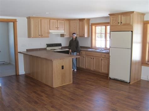 tile or cabinets first installing laminate flooring under kitchen cabinets