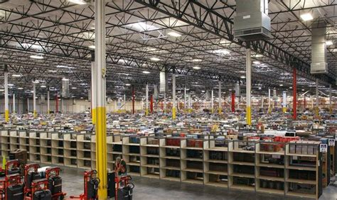 amazon speeds warehouse spending to fend off ebay wal mart