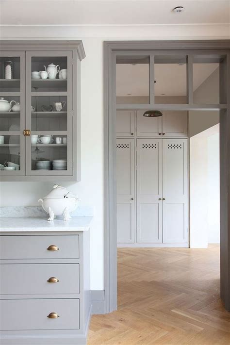 gray kitchen cabinet doors brass hardware gray kitchen cabinets and herringbone