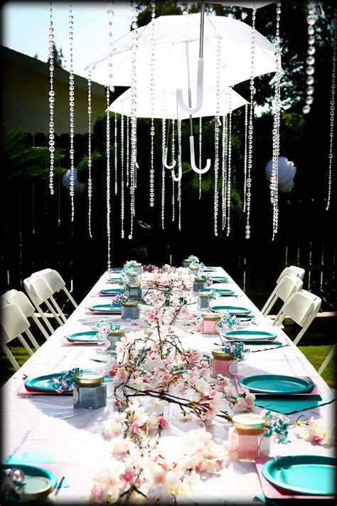Umbrellas Showering Down Crystals For Baby Shower Decor Baby Shower Umbrella Centerpieces