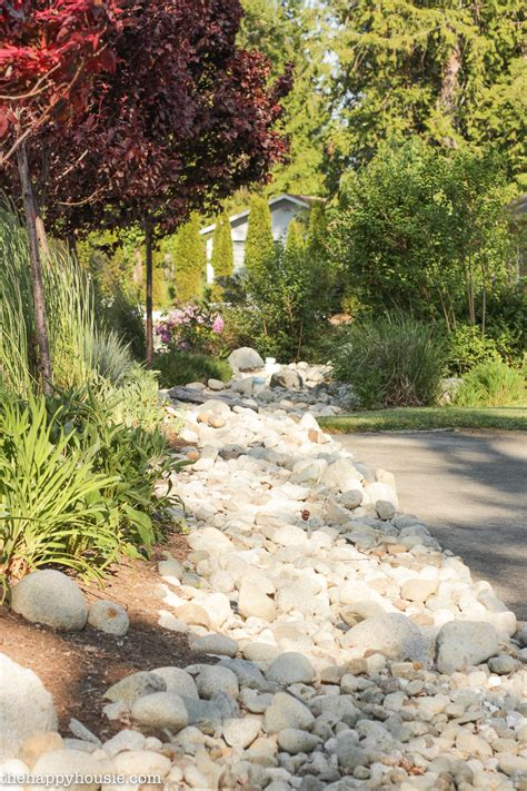 rock garden bed river rock garden bed pro lawn landscaping orono ontario