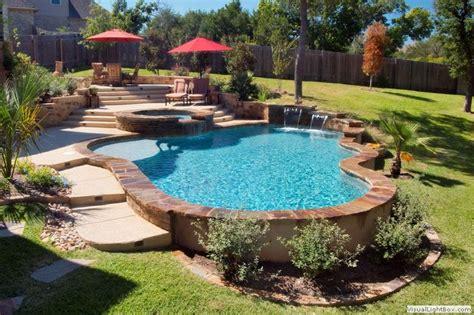 backyard pool design like the stone surround built on slope pool ideas