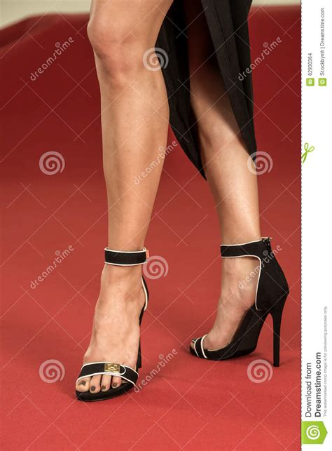 how to put on a rug with leg straps legs in fancy high heels on the carpet stock photo image of dress fashion 62930364