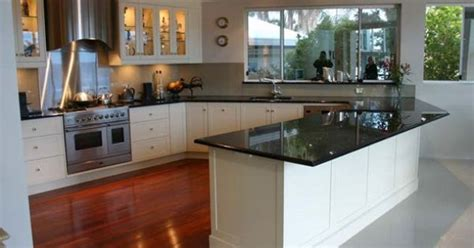black granite bench tops black granite benchtops with white shaker cabinets pretty skirting board kitchen ideas