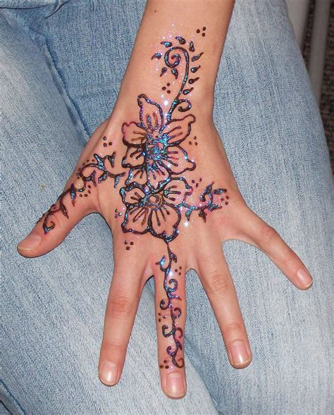 henna tattoos on hand flower henna designs design