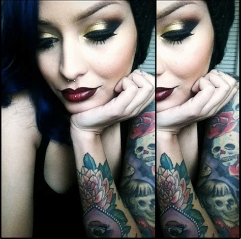 tattoo eye model gorgeous tattoo model with blue black hair bold eyes and