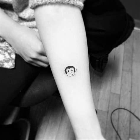 emoji monkey tattoo small monkey emoji tattoo on the forearm tattoo artist