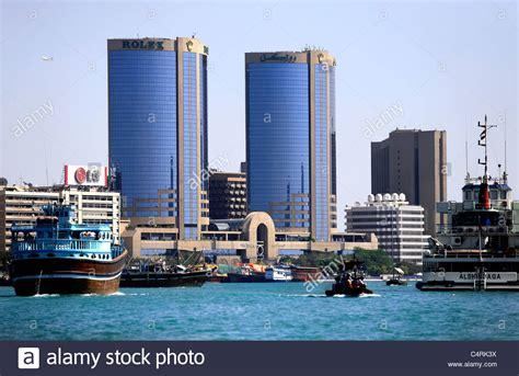 dubai boat tower deira twin towers or rolex towers and boats on the dubai