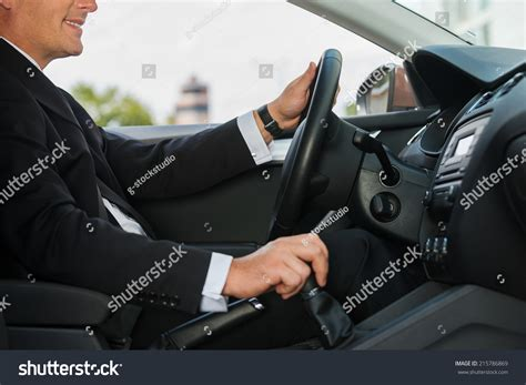driving comfort driving comfort closeup cheerful mature man stock photo