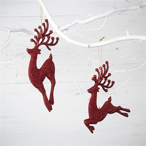 red glitter reindeer christmas decorations by the