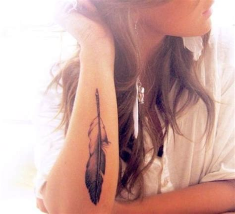 feather tattoo on girl s arm cute tattoos of feather for women tattoos pinterest