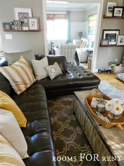 how to decorate with leather furniture how to style a dark leather sofa den makeover beneath my heart