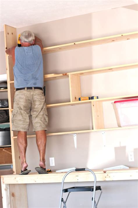 Garage Built In Shelving by How To Organize Your Garage With Custom Built In Shelving