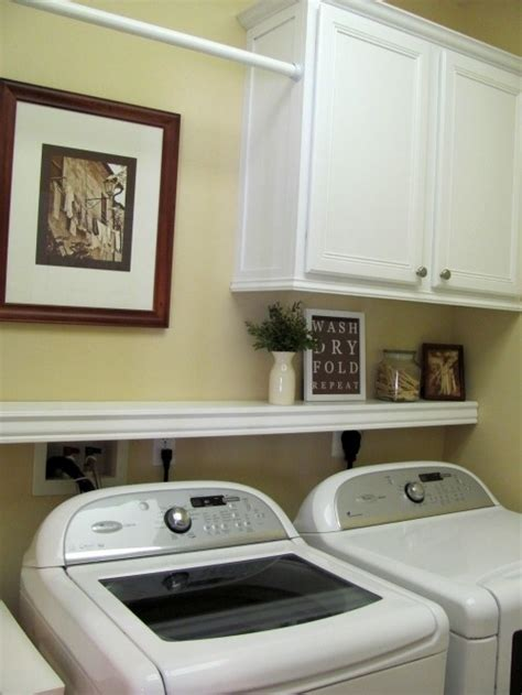 cabinets above washer dryer shelf above washer dryer also really like where they put