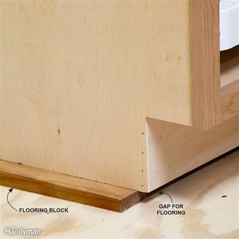 how to level kitchen base cabinets install cabinets like a pro the family handyman