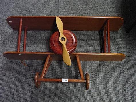 wooden biplane shelf antiques interiors