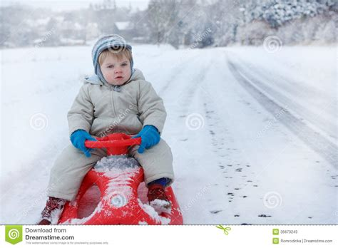 toddler boy winter clothes toddler boy with snow outdoors on