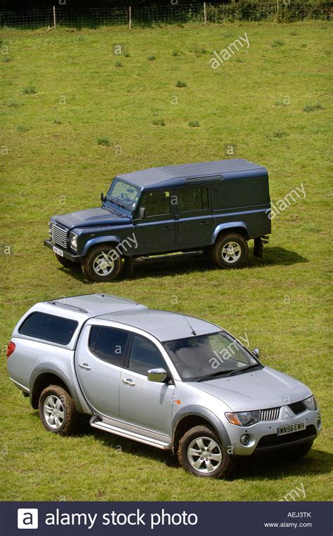 mitsubishi land rover a land rover defender and mitsubishi l200 pick up truck on