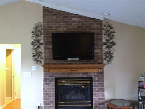 Mounting Tv Above Brick Fireplace by Tv Mounting A Fireplace With Wires Concealed In The