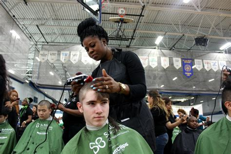 student haircuts chicago bald is brave de la salle students get buzz cuts for st